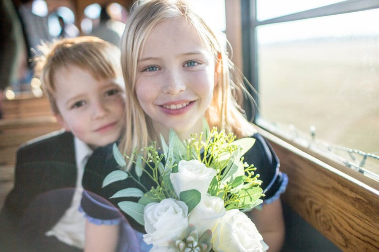 Flower girl and ring bearer on the trolley